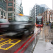 Busy london traffic in the pouring rain - Stock Photo