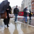 Busy london commuters in the pouring rai — Stock Photo #2867942