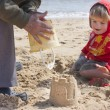 Stock Photo: Sandcastle building