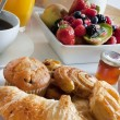 Stock Photo: Breakfast treat with fruit and pastries