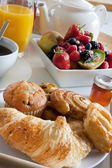 Breakfast treat with fruit and pastries — Stock Photo