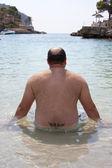 Fat man on the beach — Stock Photo