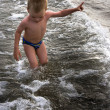 Young child playing in the sea — Stock Photo