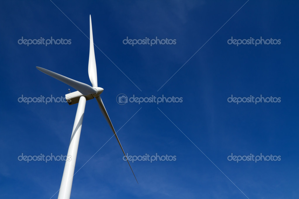 Wind turbine on clear blue sky  Stock Photo #2729652
