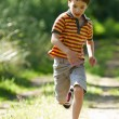 Young boy running in nature — Foto de Stock