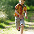 Young boy running in nature — Stok fotoğraf