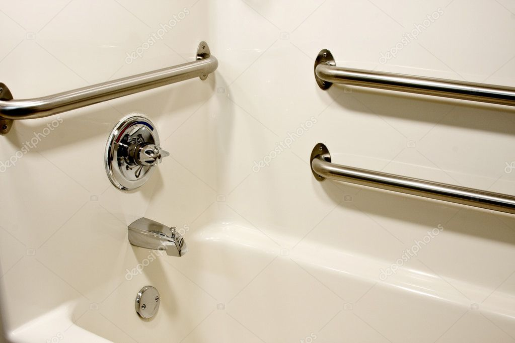 Chrome  grab safety bars in a handicap bathtub  Stock Photo #3088768