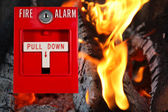 Fire alarm with fire background — Stock Photo