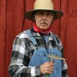 Farmer portrait  with barn background — Stock Photo