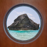 Rock in Ocean through Porthole — Stock Photo #3688103