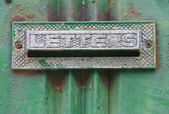Old mailbox with letters engrave — Stock Photo