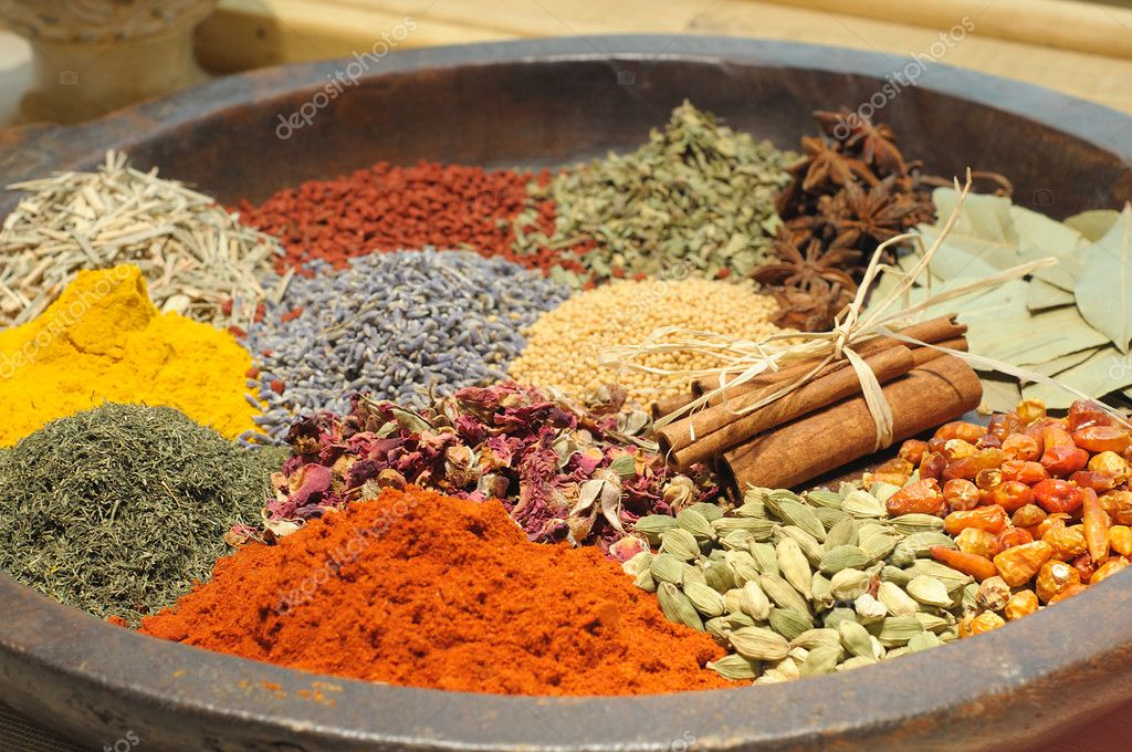 Stone plate with various colorful spices and herbs — Stock Photo #3876816