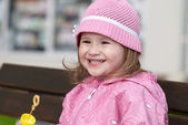 Smiling girl with a bubble wand — Stock Photo