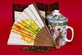 Fan and cup in asian style — Stock Photo