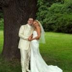 Happy wedding couple in city park — Stock Photo #2964488