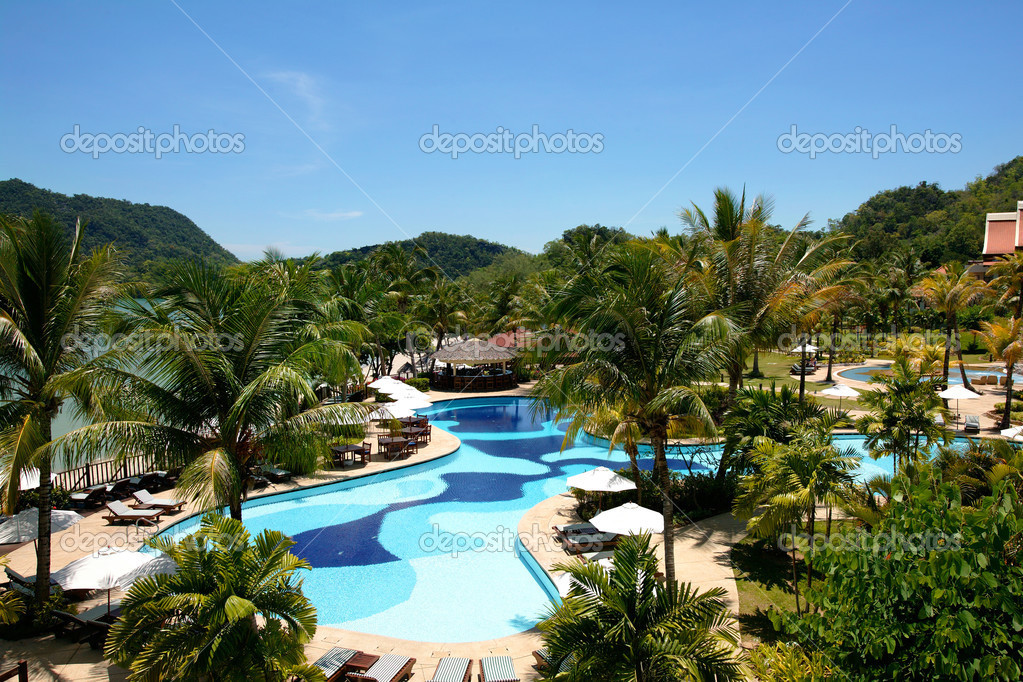Swimming pool and garden in tropical resort stock photo for Pool garden resort argao