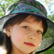 Ruddy girl in a hat — Stock Photo
