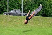 Parkour and freerunning in the city park — Stock Photo