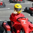 Постер, плакат: Smiling young racer