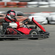 Young  racer on circuit - Stock Photo