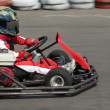Stock Photo: Young racer on circuit