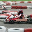 Young go cart race - Stock Photo
