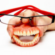 Smiling denture with glasses — Stock Photo #2723746
