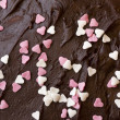 Chocolate frosting with hearts — Stock Photo #2845026