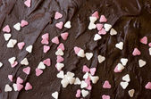 Chocolate frosting with hearts — Stock Photo