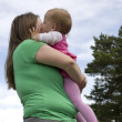 Kissing obese mother - Stock Photo