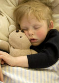 Sleeping child with teddy — Stock Photo