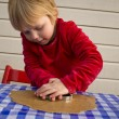 Stock Photo: Child making gingerbread cookies