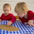 Children making gingerbread cookies — Stock Photo