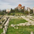 Ruins of Greek ancient cemetery with Holy Trinity Church on back - Stock Photo