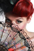 Lady with hand fan — Stock Photo