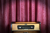 Old vintage radio on red background 2 — Stock Photo