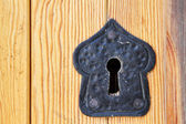 Old black keyhole on wooden door — Stock Photo