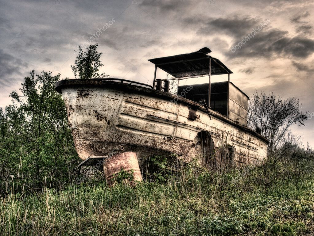 Old,rusty and abandoned river boat.Monochrome toned. — Stock Photo #2741466