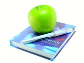 The daily log, pen and green apple; — Stock Photo
