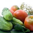 Stock Photo: Tomatoes and cucumber