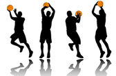 Basketball player silhouettes — Stock Vector