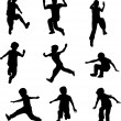 Stock Vector: Silhouettes of children jumping