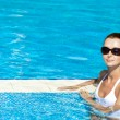 Gorgeous brunette in pool - Stock Photo