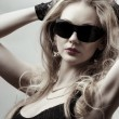 Stock Photo: Blonde wearing sunglasses