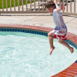 Little boy jumping into pool — Stock Photo