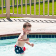 Splashing in the swimming pool - Stock Photo