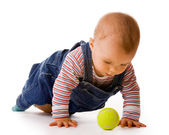 Small child in jeans with tennis ball — Stock Photo