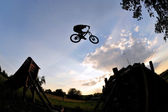 Extreme mountain bike jump — Stock Photo