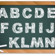 Stock Vector: Chalk Alphabet on Blackboard