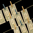 Stock Photo: Dollars on wire